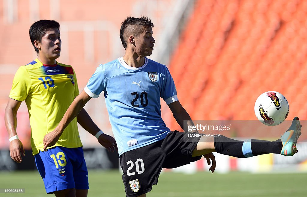 Uruguay's forward Nicolas Lopez vies for the ball with Ecuador's defender Luis Ayala (L), during their South American U-20 final round football match, at Malvinas Argentinas stadium in Mendoza, Argentina, on February 3, 2013. Four South American teams will qualify for the FIFA U-20 World Cup Turkey 2013.