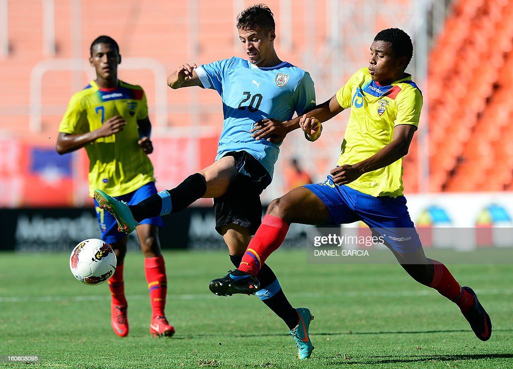 Uruguay's forward Nicolas Lopez (C) vies for the ball with Ecuador's midfielder Michael Arboleda (R), during their South American U-20 final round football match, at Malvinas Argentinas stadium in Mendoza, Argentina, on February 3, 2013. Four South American teams will qualify for the FIFA U-20 World Cup Turkey 2013.