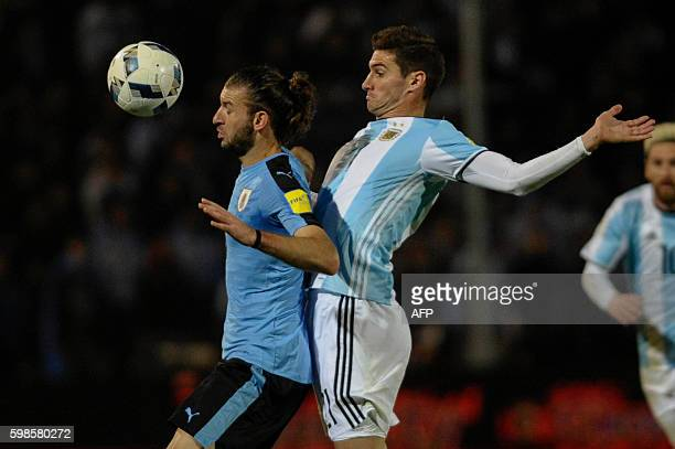 Uruguay's Gaston Silva vies for the ball with Argentina's Lucas Alario during their Russia 2018 World Cup qualifier football match in Mendoza...