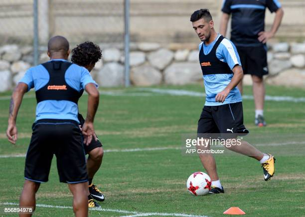 Uruguay's Giorgian De Arrascaeta controls the ball during a training session at the Puerto Azul Club field in La Guaira Venezuela on October 2 2017...