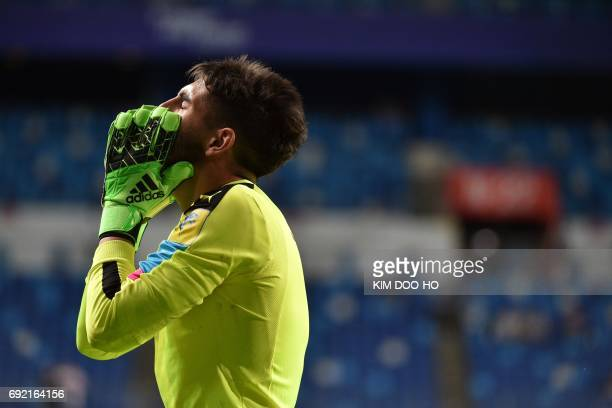 Uruguay's goalkeeper Santiago Mele reacts after making a save during the penalty shootout in the U20 World Cup quarterfinal football match between...
