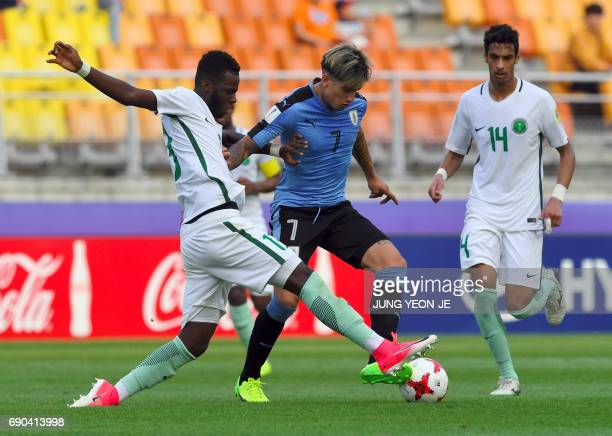 Uruguay's Joaquin Ardaiz fights for the ball with Saudi Arabia's Hassan Altambakti and Ali Alasmari during their U20 World Cup round of 16 football...