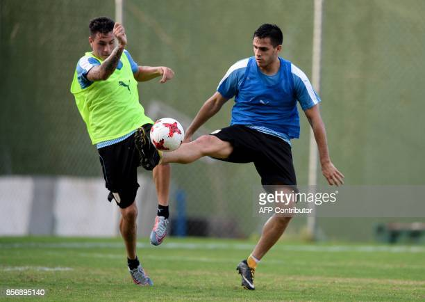 Uruguay's Jose MAria Gimenez and Gaston Pereiro vie for the ball during a training session at the Puerto Azul Club field in La Guaira Venezuela on...