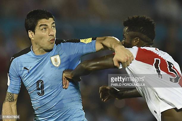 Uruguay's Luis Suarez and Peru's Christian Ramos vie for the ball during their Russia 2018 FIFA World Cup South American Qualifiers' football match...