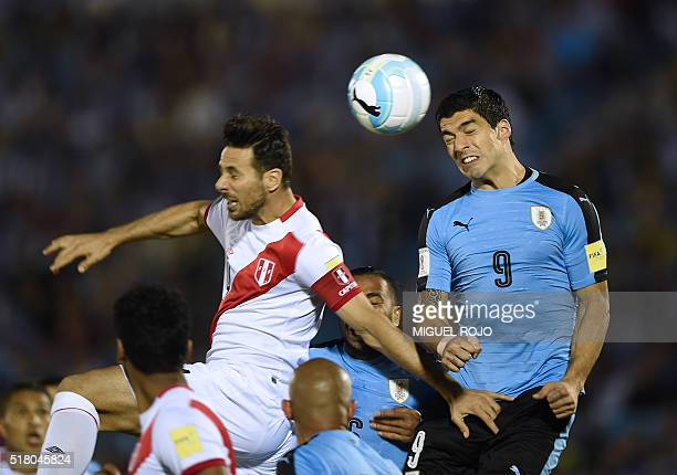 Uruguay's Luis Suarez and Peru's Claudio Pizarro jump for a header during their Russia 2018 FIFA World Cup South American Qualifiers' football match...