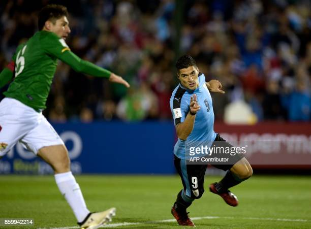 Uruguay's Luis Suarez celebrates after scoring against Bolivia during their 2018 World Cup football qualifier match in Montevideo on October 10 2017...