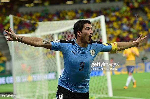Uruguay's Luis Suarez celebrates after scoring against Brazil during their Russia 2018 FIFA World Cup South American Qualifiers' football match in...
