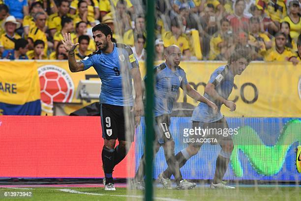 Uruguay's Luis Suarez celebrates after scoring against Colombia during their Russia 2018 World Cup football qualifier match in Barranquilla Colombia...