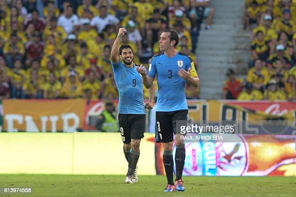 Uruguay's Luis Suarez celebrates next to Uruguay's Diego Godin after scoring against Colombia during their Russia 2018 World Cup football qualifier...