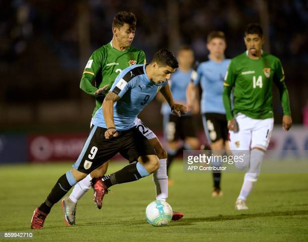 Uruguay's Luis Suarez fights for the ball with Bolivia's Jordy Candia during their 2018 World Cup football qualifier match in Montevideo on October...