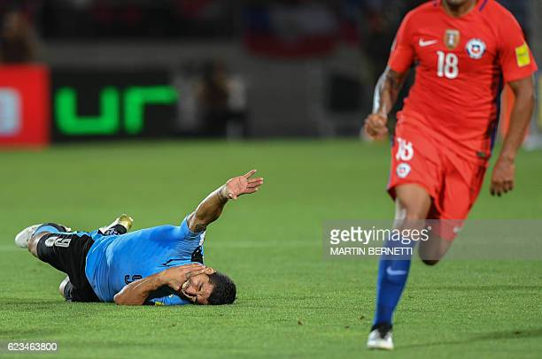 TOPSHOT Uruguay's Luis Suarez gestures during their 2018 FIFA World Cup qualifier football match in Santiago on November 15 2016 / AFP / Martin...