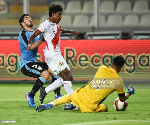 Uruguay's Luis Suarez Peru's defender Miguel Araujo and Peru's goalkeeper Pedro Gallese vie for the ball during the 2018 FIFA World Cup qualifier...
