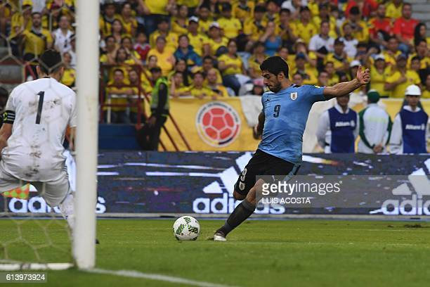 TOPSHOT Uruguay's Luis Suarez shoots to score against Colombia during their Russia 2018 World Cup qualifier football match in Barranquilla Colombia...