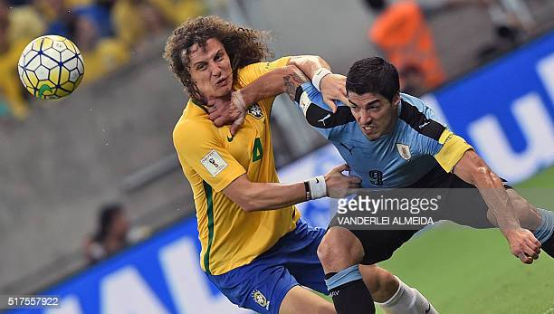 Uruguay's Luis Suarez vies for the ball with Brazil's David Luiz during their Russia 2018 FIFA World Cup South American Qualifiers' football match in...