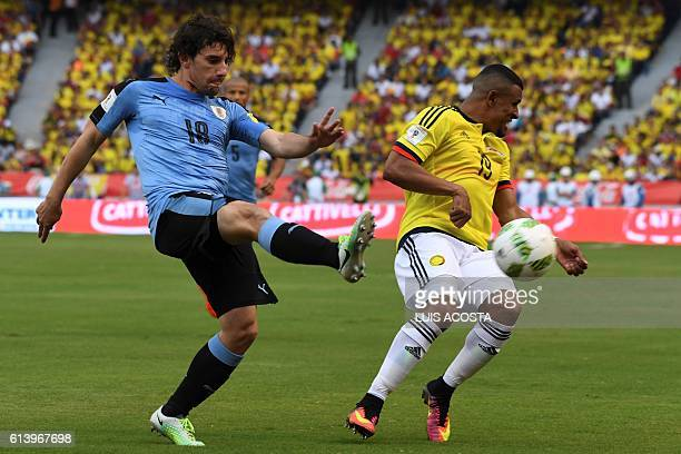 Uruguay's Mathias Corujo kicks the ball next to Colombia's Farid Diaz during their Russia 2018 FIFA World Cup qualifier football match in...