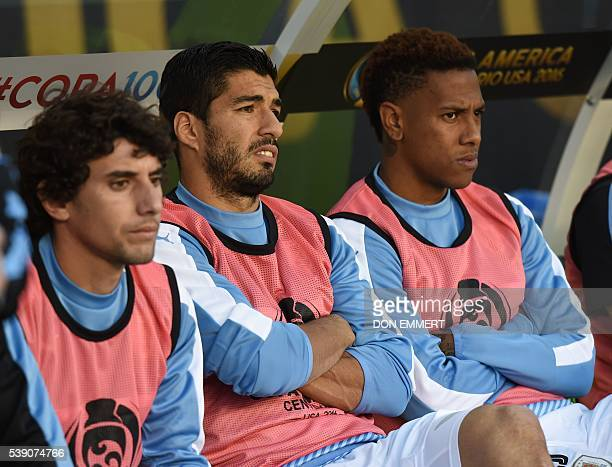 Uruguay's Mathias Corujo Luis Suarez and Abel Hernandez are seen on the substitute's bench during the Copa America Centenario football tournament...