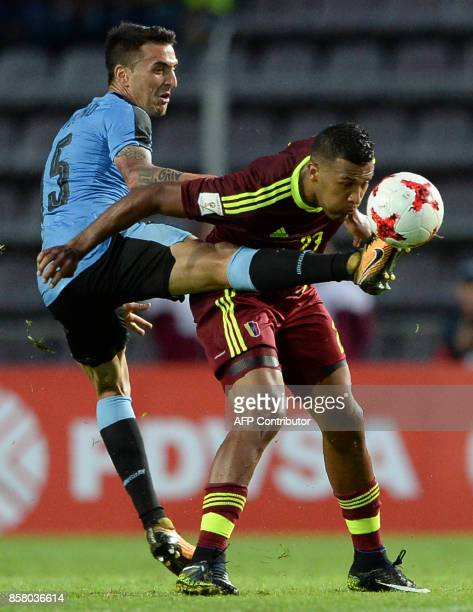 Uruguay's Matias Vecino and Venezuela's Salomon Rondon vie for the ball during their 2018 World Cup qualifier football match in San Cristobal...
