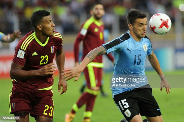 Uruguay's Matias Vecino is marked by Venezuela's Salomon Rondon during their 2018 World Cup qualifier football match in San Cristobal Venezuela on...