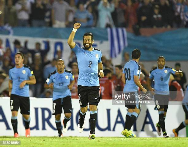 Uruguay's Mauricio Victorino celebrates after teammate Edinson Cavani scored against Peru during their Russia 2018 FIFA World Cup South American...