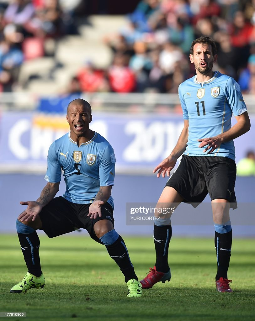 Uruguay's midfielder Carlos Sanchez (L) and Uruguay's forward Christian Stuani react during their 2015 Copa America football championship match against Paraguay, in La Serena, on June 20, 2015.
