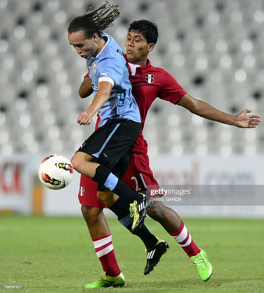 Uruguay's midfielder Diego Laxalt Suarez (L) vies for the ball with Peru's midfielder Raziel Garcia during their South American U-20 final round football match at Malvinas Argentinas stadium in Mendoza, Argentina, on January 20, 2013. Uruguay won by 3-1. Four teams will qualify for the FIFA U-20 World Cup Turkey 2013.