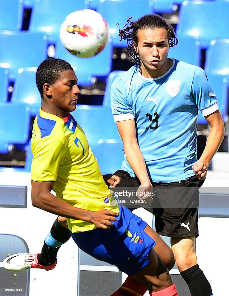 Uruguay's midfielder Diego Laxalt Suarez (R) vies for the ball with Ecuador's midfielder Carlos Gruezo, during their South American U-20 final round football match, at Malvinas Argentinas stadium in Mendoza, Argentina, on February 3, 2013. Four South American teams will qualify for the FIFA U-20 World Cup Turkey 2013.