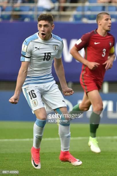 Uruguay's midfielder Federico Valverde celebrates beside Portugal's defender Ruben Dias after scoring during their U20 World Cup quarterfinal...
