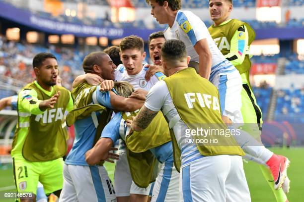 Uruguay's midfielder Federico Valverde is congratulated by teammates after scoring during their U20 World Cup quarterfinal football match between...