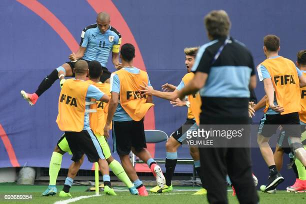 Uruguay's midfielder Nicolas De La Cruz celebrates his goal with teammates during the U20 World Cup semifinal football match between Uruguay and...