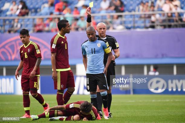 Uruguay's midfielder Nicolas De La Cruz receives a yellow card during the U20 World Cup semifinal football match between Uruguay and Venezuela in...