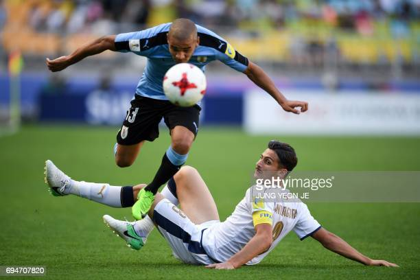 Uruguay's midfielder Santiago Viera and Italy's midfielder Rolando Mandragora compete for the ball during the U20 World Cup third place playoff...
