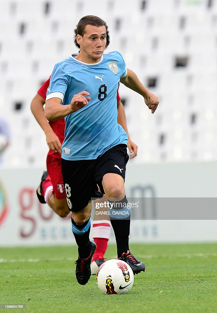 Uruguay's midfielder Sebastian Cristoforo controls the ball during their South American U-20 final round football match against Peru at Malvinas Argentinas stadium in Mendoza, Argentina, on January 20, 2013. Four teams will qualify for the FIFA U-20 World Cup Turkey 2013.