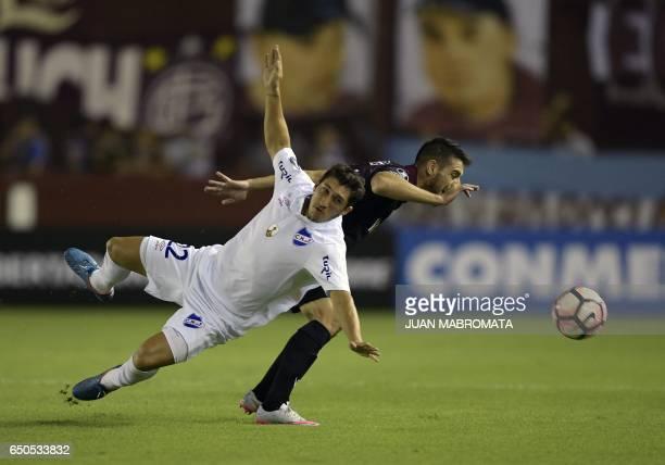 Uruguay's Nacional defender Luis Espino vies for the ball with Argentina's Lanus forward Alejandro Silva during the Copa Libertadores 2017 group...