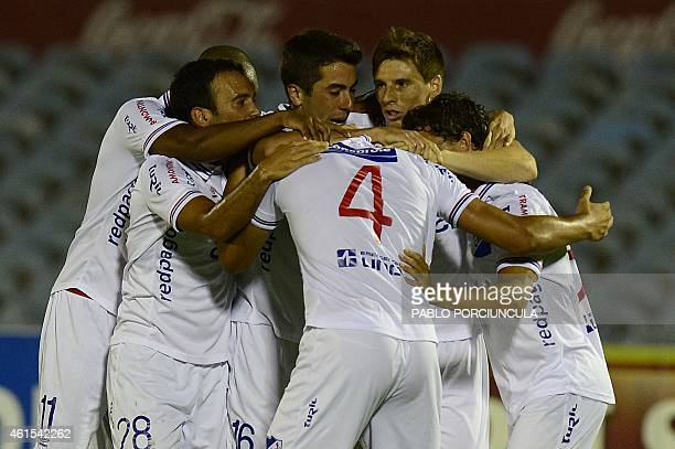Uruguay's Nacional footballers celebrate after scoring against Peru's Universitario during the final Bandes Cup match at the Centenario stadium in...