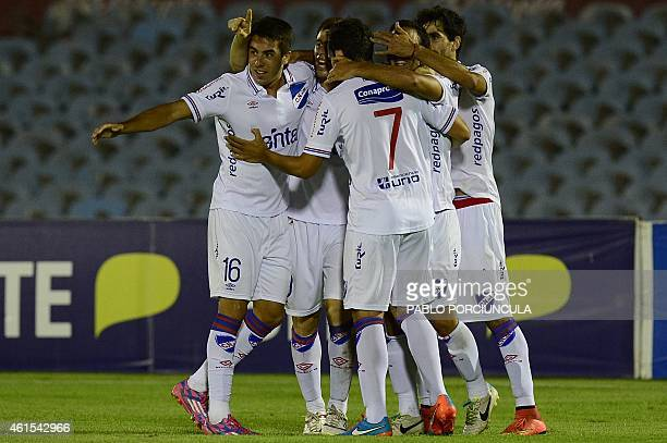 Uruguay's Nacional footballers celebrate the second goal against Peru's Universitario during their Bandes Cup match at the Centenario stadium in...