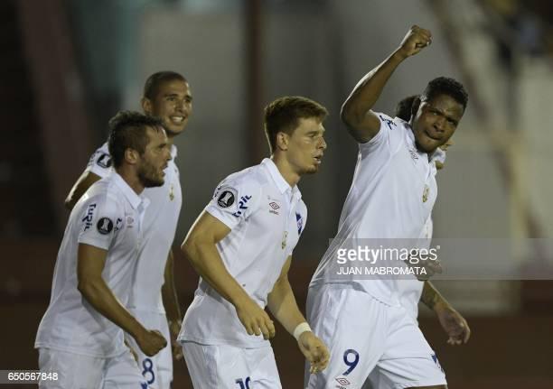 Uruguay's Nacional forward Hugo Silveira celebrates with teammates after scoring a goal against Argentina's Lanus during the Copa Libertadores 2017...