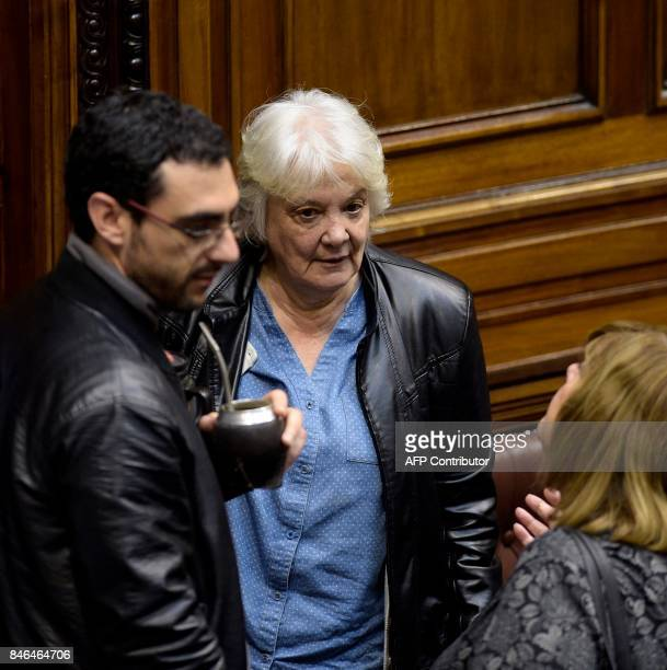 Uruguay's new vicepresident Lucia Topolansky talks with fellow lawmakers after her swearingin ceremony in Montevideo on September 13 2017 Topolansky...