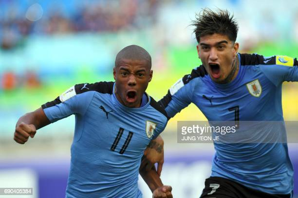 Uruguay's Nicolas De La Cruz celebrates his goal with teamamte Joaquin Ardaiz during their U20 World Cup round of 16 football match between Uruguay...