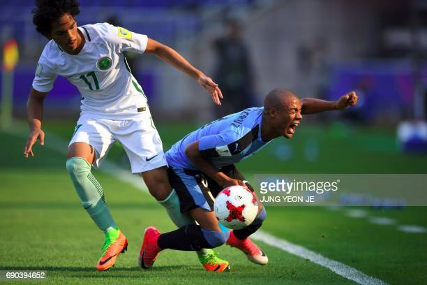 Uruguay's Nicolas De La Cruz fights for the ball with Saudi Arabia's Abdullah Tarmin during their U20 World Cup round of 16 football match between...