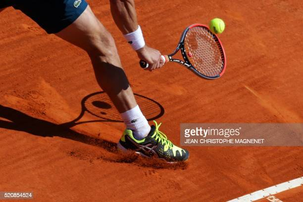 Uruguay's Pablo Cuevas hits a return to Canada's Milos Raonic during their MonteCarlo ATP Masters Series Tournament tennis match on April 13 2016 in...