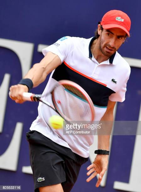 Uruguay's Pablo Cuevas returns a ball to Austria's Sebastian Ofner at the ATP General Open Kitzbuehel Tennis Tournament on August 1 2017 in Kitzbühel...