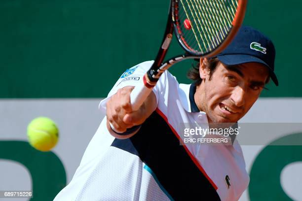 Uruguay's Pablo Cuevas returns the ball to France's Maxime Hamou during their tennis match at the Roland Garros 2017 French Open on May 29 2017 in...