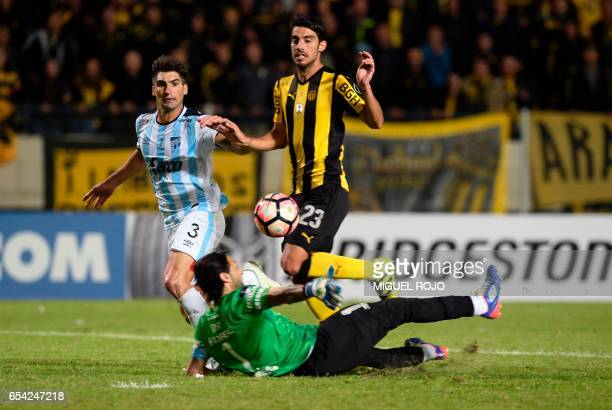 Uruguay's Penarol Gaston Rodriguez scores his team's second goal against Argentina's Atletico Tucuman during their Libertadores Cup football match at...