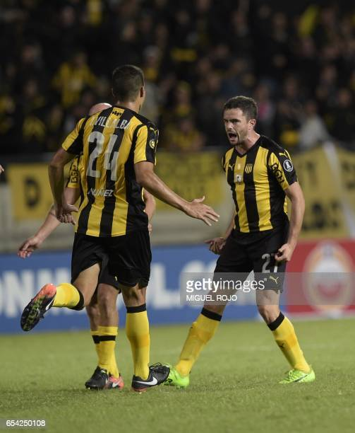 Uruguay's Penarol Lucas Hernandez celebrates with teammates after scoring against Argentina's Atletico Tucuman during their Libertadores Cup football...
