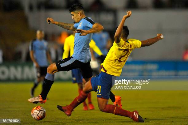 Uruguay's player Joaquin Ardaiz vies for the ball with Ecuador's Luis Segovia during their South American Championship U20 football match at the...