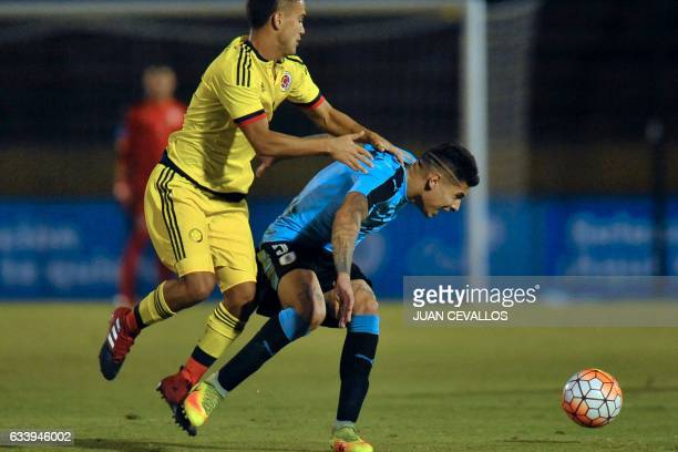 Uruguay's player Mathias Olivera vies for the ball with Colombia's player Daniel Rojano Gomez during their South American Championship U20 football...