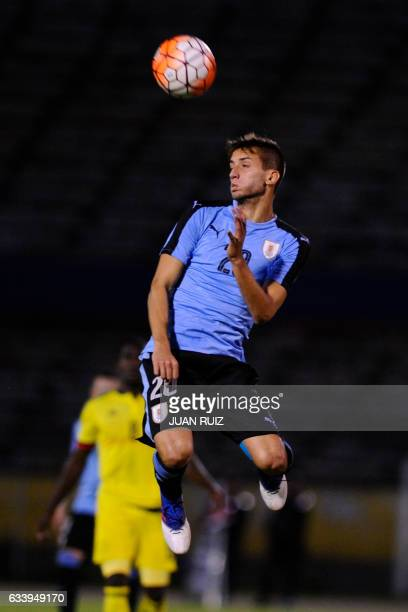 Uruguay's player Rodrigo Bentancur jumps to head the ball during a South American Championship U20 football match against Colombia at the Olimpico...