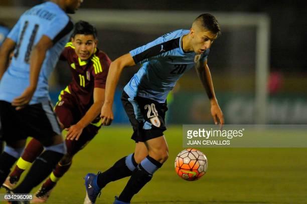 Uruguay`s player Rodrigo Bentancur vies for the ball with Venezuela's player Ronaldo Chacon during their South American Championship U20 football...