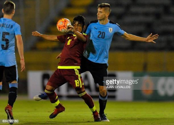 Uruguay's player Rodrigo Bentancur vies for the ball with Venezuela's player Luis Ruiz during their South American Championship U20 football match in...