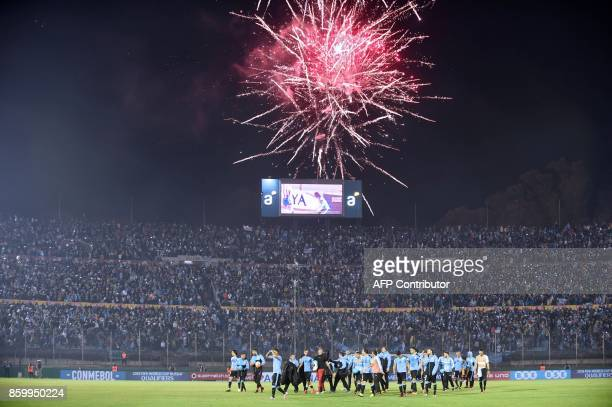 Uruguay's players and team staffers celebrate with supporters after defeating Bolivia 42 during their 2018 World Cup football qualifier match in...